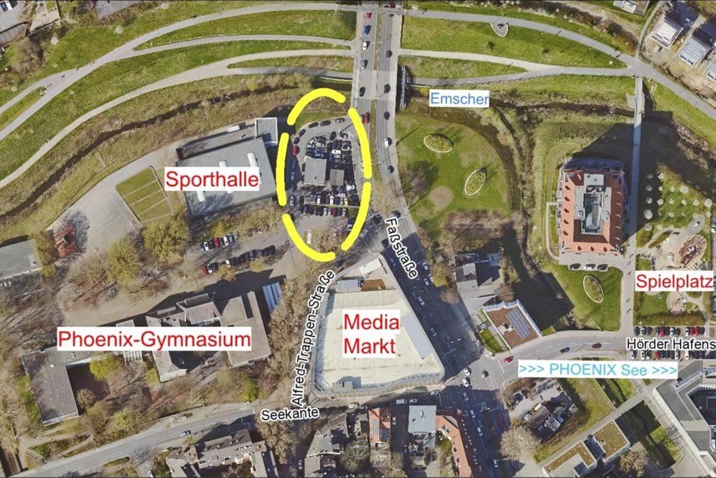 Der bislang von einem Autohandel blockierte Bereich vor der Sporthalle am Phoenix-Gymnasium wird neu gestaltet.