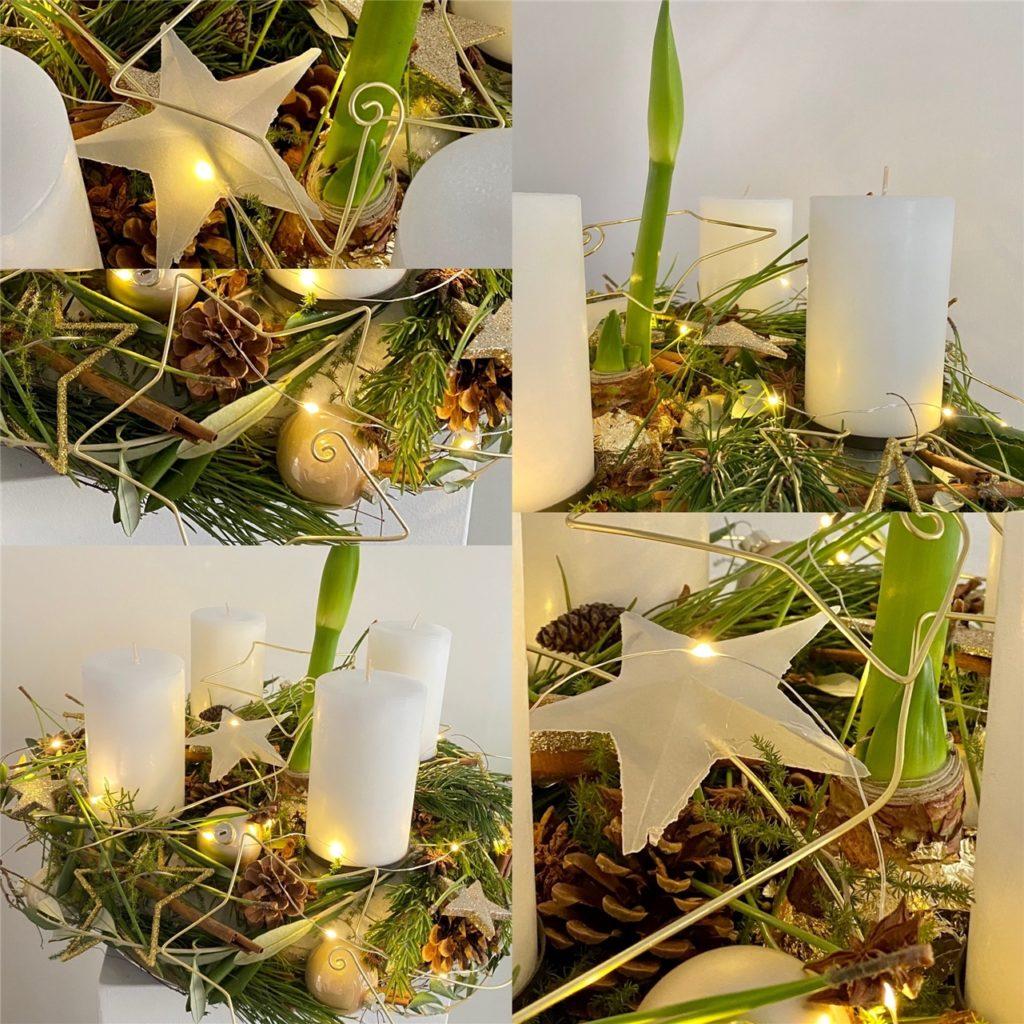 Ein schlichter Adventskranz mit weißen Kerzen, Lichterkette und Sternen.