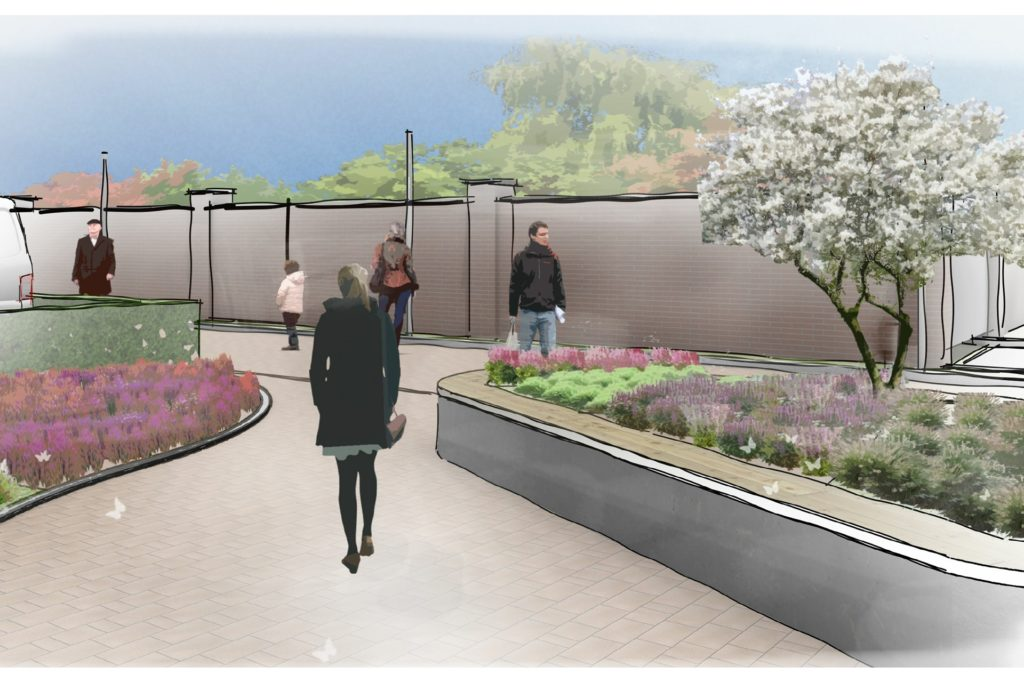 Blumenbeet, Hochbeet und Heek fassen die Laufwege, hier mit Blick zur Pfarrgartenmauer hin.